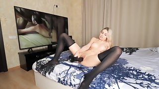 Beauty blonde masturbates on cam anent her monster dildo